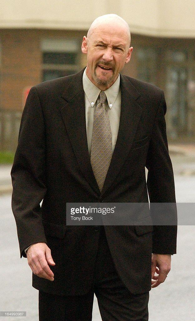 DAVIES - 05/10/04 - Former Durham Crown Attorney, Bryan Davies, walks into Oshawa court this ...