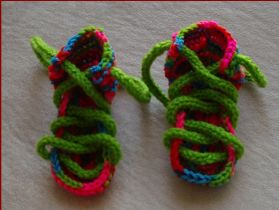 Knitting pattern for lace up 8ply baby sandals.