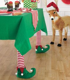 Elf table leg covers - Sold Out but a friend pointed out they'd be so easy to make. Use Christmas socks or girl's tights and cut out felt elf shaped shoes, glue together and stuff with batting or plastic grocery bags.