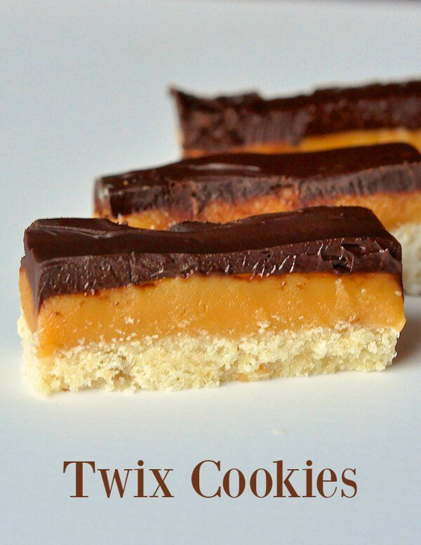 These Twix cookies were inspired by the famous candy bar; indulgent bar cookies with a buttery shortbread base, caramel center and rich chocolate top layer.