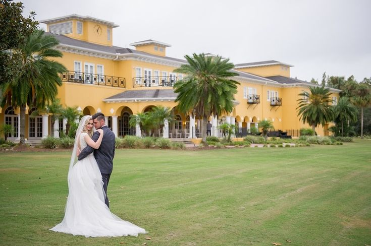 Outdoor Garden Bride and Groom Wedding Portrait, Bride in Ballgown Wedding Dress from Tampa Bridal Boutique The Bride Tampa, Groom in Grey Tux | Tampa Bay Elegant Country Club Wedding Ceremony Venue The Tampa Palms Golf & Country Club | Tampa Wedding Photographer Andi Diamond Photography