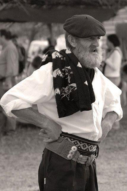 Gaucho, watching a rodeo, San Antonio de Areco, Argentina