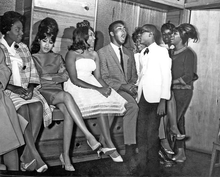 Darlene Love (The Crystals), Ronnie Spector (The Ronettes), Dee Dee Sharp, Muhammad Ali, Dionne Warwick, 13 year old Stevie Wonder and Micki Harris (The Shirelles) at The Apollo, Harlem USA, 1963 (via All Girl Bands on Facebook)