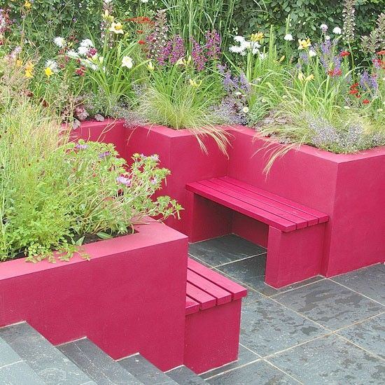 Colourful modern garden  Not for the faint-hearted, this colourful garden has hot pink, built-in seats that double as plant containers. Combined with the slate floor tiles, the pink is all the more striking, while the lush green plants help to add to the summery feel.  Chosen by Housetohome