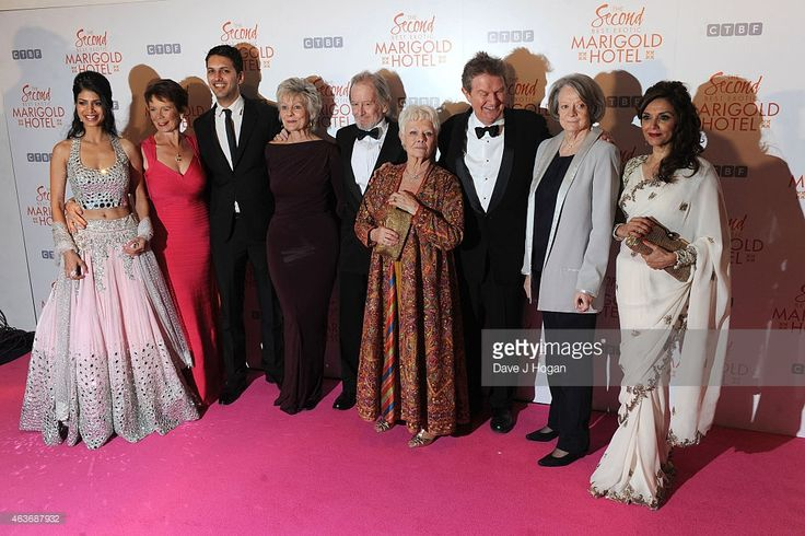 Tina Desai, Celia Imrie, Shazad Latif, Diana Hardcastle, Ronald Pickup, Dame Judi Dench, John Madden, Dame Maggie Smith and Lillete Dubey attend The Royal Film Performance and World Premiere of 'The Second Best Exotic Marigold Hotel' at Odeon Leicester Square on February 17, 2015 in London, England.