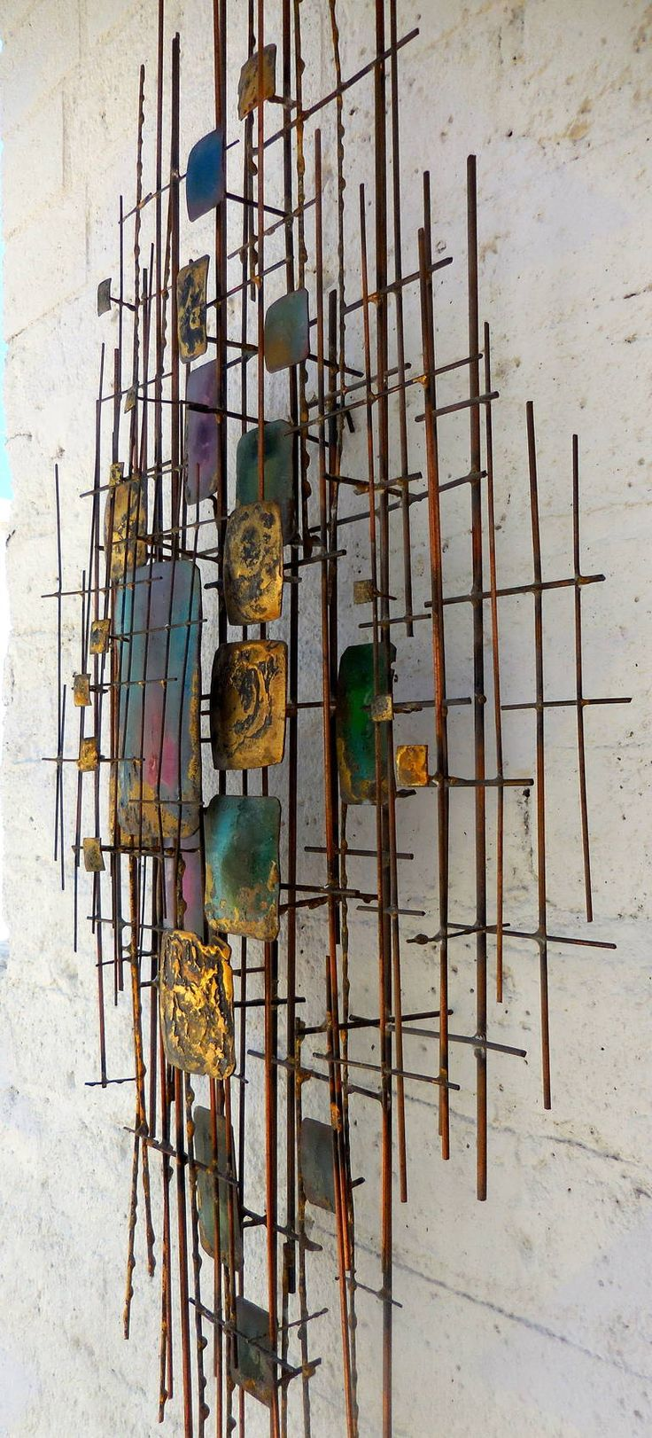 Beautifully Scaled 1950s Gilded Metal and Enamel Wall Sculpture | From a unique collection of antique and modern wall-mounted sculptures at https://www.1stdibs.com/furniture/wall-decorations/wall-mounted-sculptures/