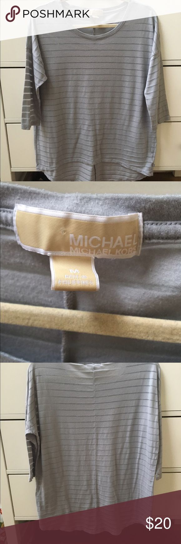 Michael kors tshirt 3/4 sleeves. Sheer. Light gray  high low effect. Great condition MICHAEL Michael Kors Tops Tees - Long Sleeve