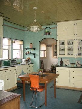 Seafoam blue counters and walls with a peacock blue kitchen floor in hex tiles