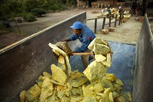Sulfur-miner-unloads-his-load-of-sulfur-into-a-truck.jpg