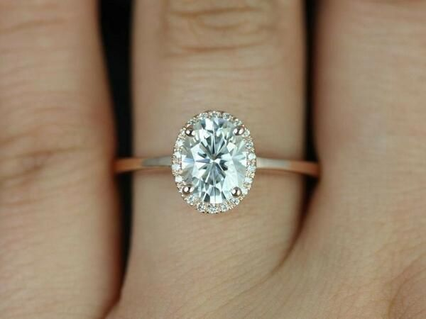 Simple Rose Gold band, platinum head,  oval centre diamond with halo. Beautiful.