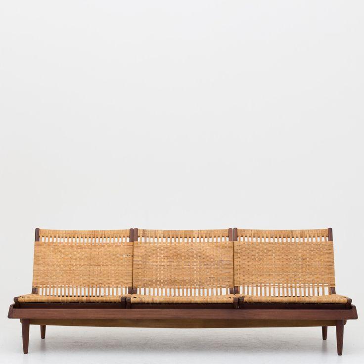 Modular sofa in teak and cane