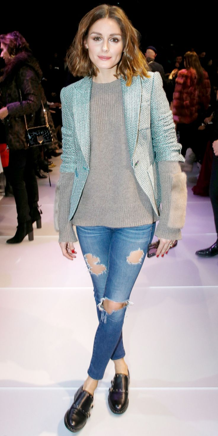 Your distressed denim pieces aren't just for the weekends. Olivia Palermo showed us how to make them look fashion-show appropriate, pairing her's with a gray sweater, mint blazer, and studded flats