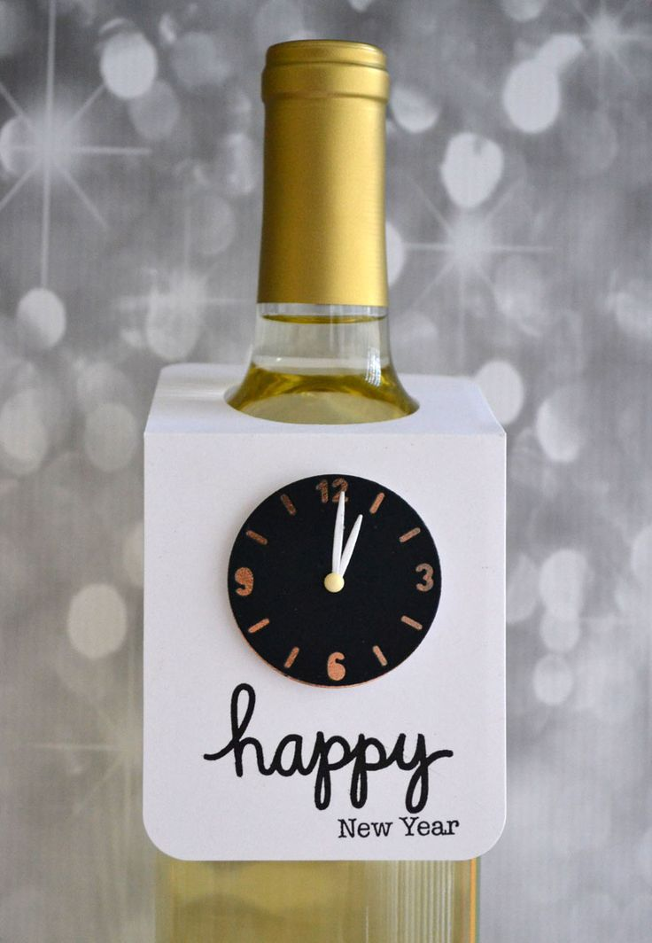 A fun idea for New Year's Eve: Dress up a bottle of sparkling cider, champagne or wine with a fun tag. Click on the photo for the how-to.