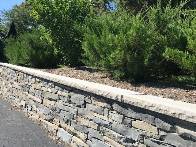 Natural Stone Walls Are Sturdy And Beautiful Planning Each Piece To Fit Perfectly With Another Is Like Landscape Design Landscape Projects Spring Landscaping