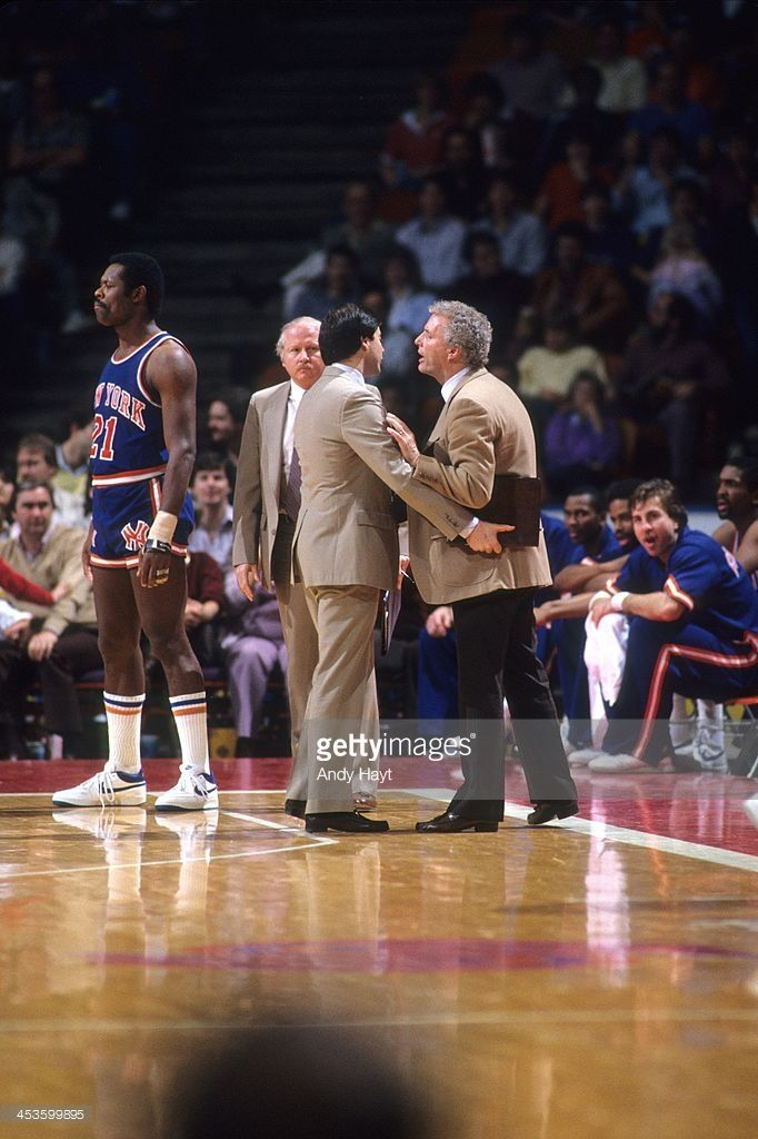 New York Knicks head coach Hubie Brown upset, being restrained by assistant coach Rick Pitino during game vs Houston Rockets at The Summit. Andy Hayt F16 )