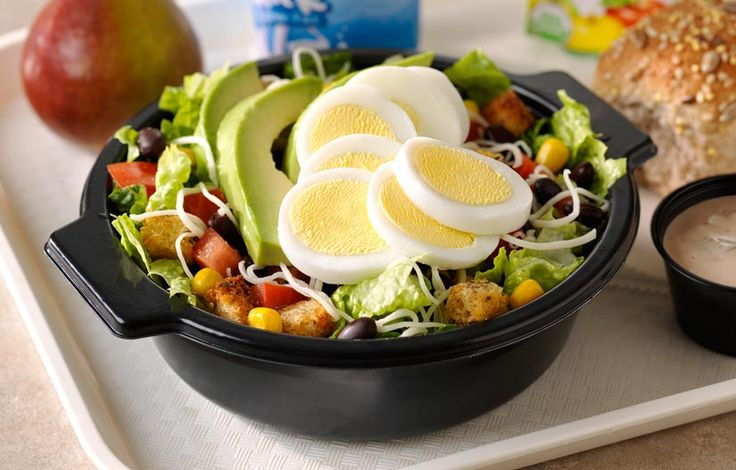 Southwest Cobb Salad: Top romaine lettuce with egg and avocado slices, diced tomatoes, sweet corn, seasoned black beans and shredded mozzarella cheese, with salsa ranch dressing and whole-grain croutons