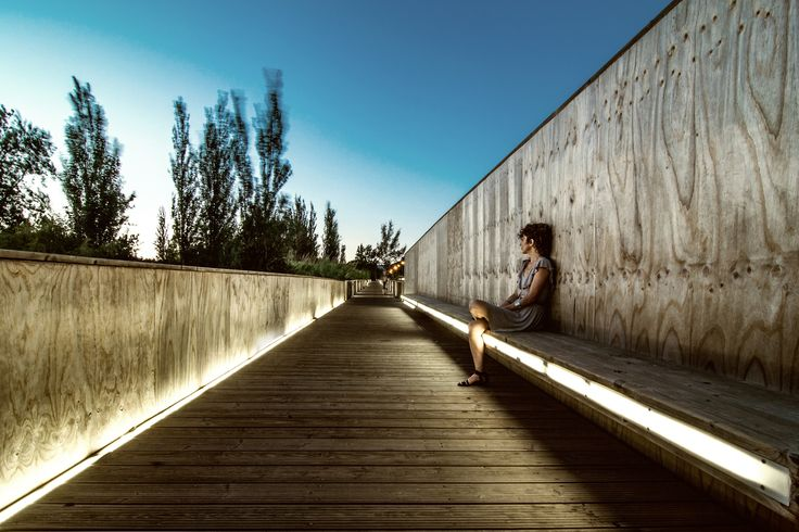 Built by AND-RÉ in Quarteira, Portugal with date 2009. Images by João Soares. VLM bridge is a pedestrian and bike bridge, part of a wider intervention in a main avenue in the city of Vilamoura. T...
