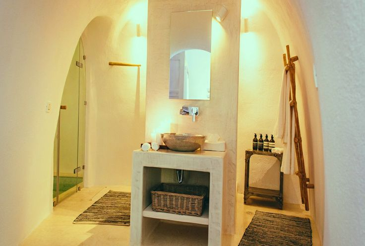 Lavish comforts of The Iconic Suite include a large rain shower and a basin...