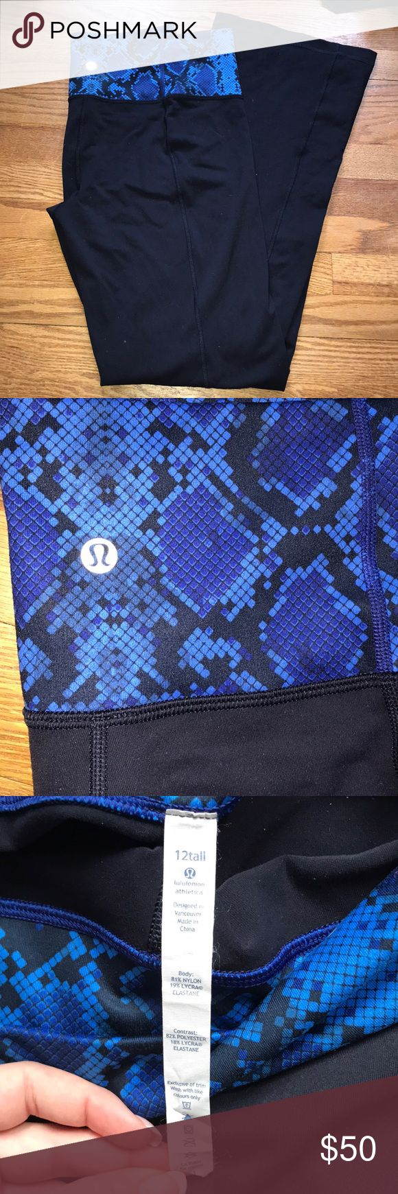 Lululemon Navy snake skin yoga pants 12 tall EUC. Only worn a couple times. Navy and royal blue snake skin lululemon yoga pants. Size 12 tall. I think they run a bit big. They are the regular style wider bottom yoga pant. They are navy not black and have the colored waist band. They are in amazing condition no pilling or holes anywhere. Perfect for tall girls! lululemon athletica Pants Track Pants & Joggers