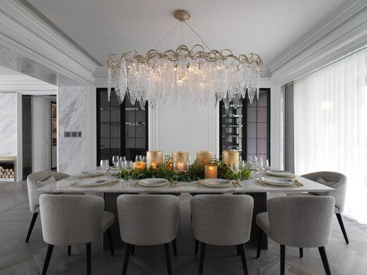 Scale The Large Thick Chandelier Over Long Thin Table