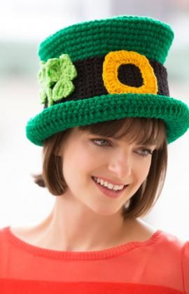 St. Patrick's Day Chapeau - Here's to love and laughter! This hat is the perfect way to celebrate St. Patrick's Day in lucky Irish style…complete with a pair of crocheted shamrocks and gold buckle.
