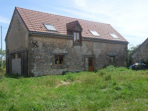 Old stone barn in process of converting to a house om 2 acres. New roof, electrics, plumbing. 93,000 EUR
