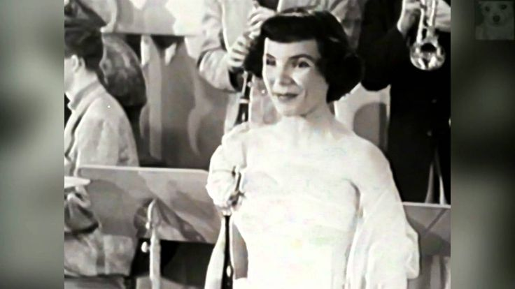 Teresa Brewer - Music Music Music. This was her first big hit: A #1 record in 1949. It's such a wonderful pop song and she's cute as a button. :))