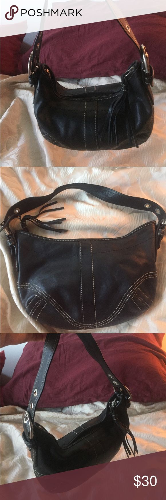 Black Coach Shoulder Bag Authentic black Coach purse. It's small, and fits right over the shoulder. The leather is still in great condition, and there are no tears or worn down patches. There is some where on the metal buckles (as shown in the pictures). Coach Bags Shoulder Bags