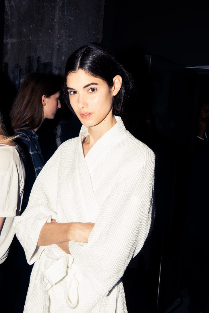 Backstage at the Ellery Spring 2017 Show: Model Backstage in White Bathrobe | coveteur.com