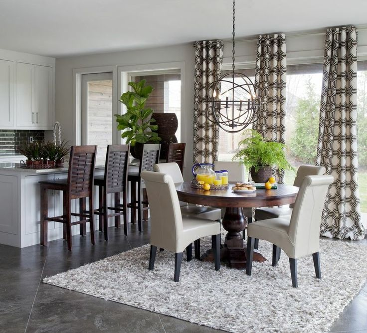 Amazing Dining Room With The Geometric Circle Drapery Panels Beige Leather Chairs Dark Wood Round Pedestal Table