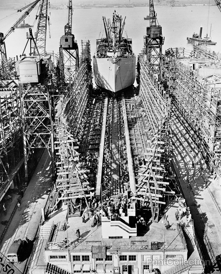 Bethlehem Fairfield shipyards, near Baltimore, Maryland. Construction of a Liberty ship. The ship sliding down the ways just twenty-four days after her keelplates were laid. It will take ten days long
