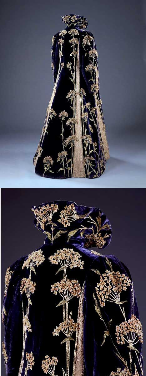 Marshall and Snelgrove Ltd 1895-1900 Purple velvet coat with Medieval-style collar. Entirely covered with dramatic sprays of an English wildflower called Sweet Cicely that are hand-embroidered in yellow and green silk, with petals of white felt.
