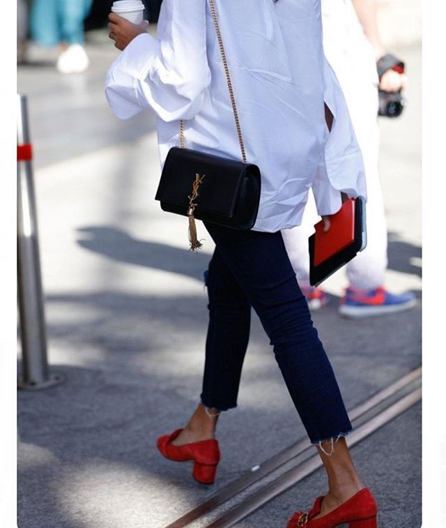 A great pair of red shoes + a classic white men's shirt + dark denim and a ysl bag