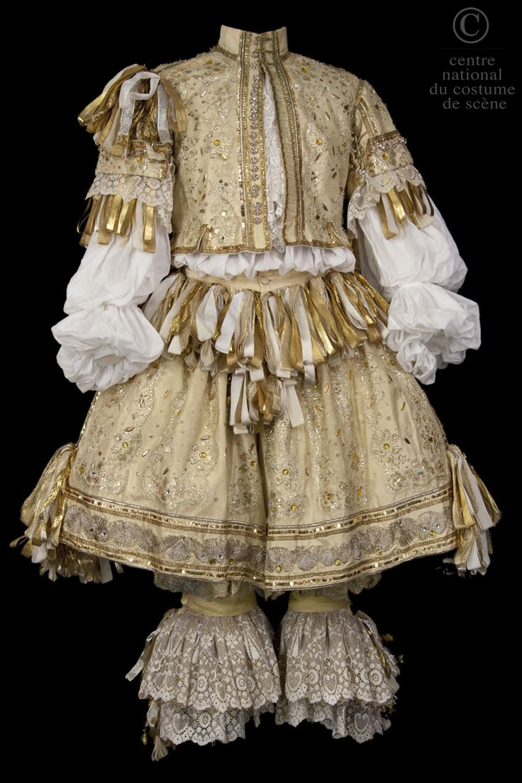 Louis XIV STYLE late 1600's COSTUME DESCRIPTION:  Jerkin pale yellow silk, lace applications gold and glitter. Bloomers with pale yellow silk covered with gold mesh. Canons lace. Rhingrave pale yellow silk. Gold ribbons, white, yellow. Braid and gold sequins. WORK:  Precious ridiculous (The) COMPOSER / AUTHOR  after Molière DIRECTOR:  Jean-Luc Boutté DATE OF PRODUCTION:  1993-02-06 PLACE OF PRODUCTION:  French comedy, Paris (Salle Richelieu)
