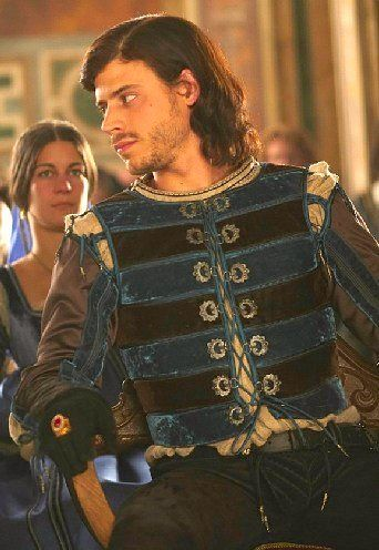 Francois Arnaud as Cesare Borgia in a rich looking velvet and silk costume.
