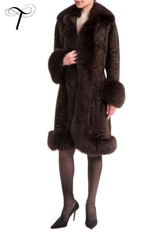 Toutountzis Furs | PERSIAN LAMB COAT   This dashing, #stylish chocolate-brown #furcoat provides a smart, #feminine option for your winter #outwear collection. Crafted from beautifully patterned #swakara pelts it is cut closely to the figure with a light nipped-in waist and a spread collar. A plush #foxfur trimming adorns the collar, both front sides, the cuffs and the hem giving an extra touch of opulence to the garment.A treasured investment with classic allusions for years to come.