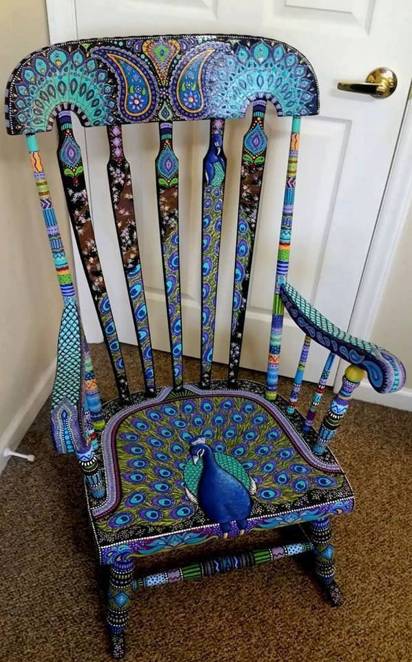 A beautifully painted peacock rocking chair by Kay Larch