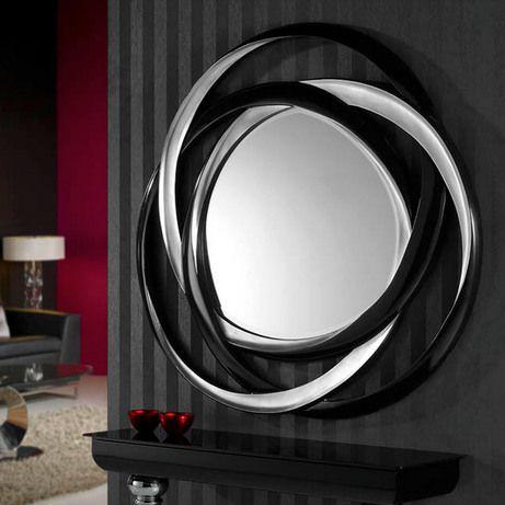 Зеркало с фаской в формованной раме, выполненной в виде трех переплетенных колец покрытых серебряной…