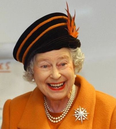 Queen Elizabeth II smiles during a visit to The Royal Veterinary College in Hertfordshire on Oct. 30, 2003. Photo by Kirsty Wigglesworth