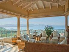 This house is situated in Whale Rock, Plettenberg Bay within a private secure estate.  This exclusive residence has open plan living onto an expansive patio with elevated uninterrupted views of the bay. It is the ideal setup for both holiday or permanent living.