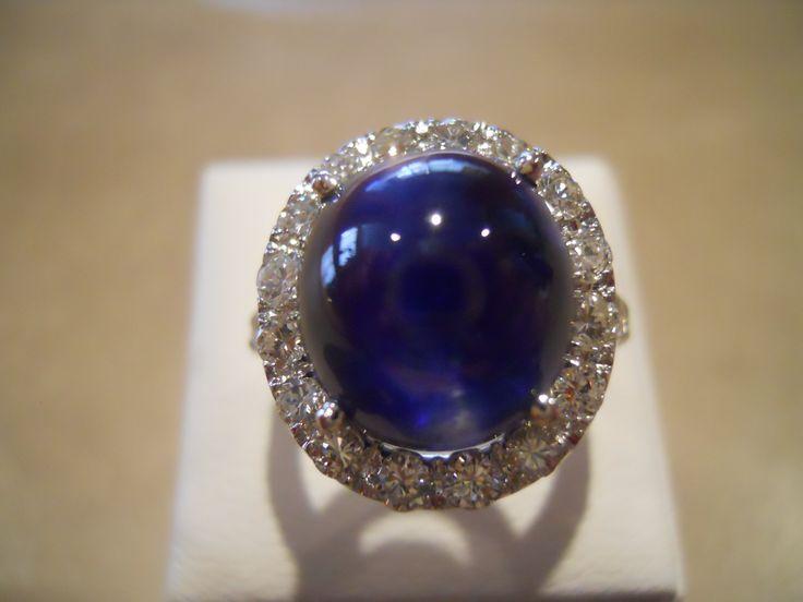 """Blue silk"" ring Natural cabochon sapphire, diamonds, white gold."