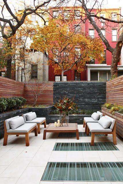 Private slice of heaven in an urban jungle. Love the design of the furniture