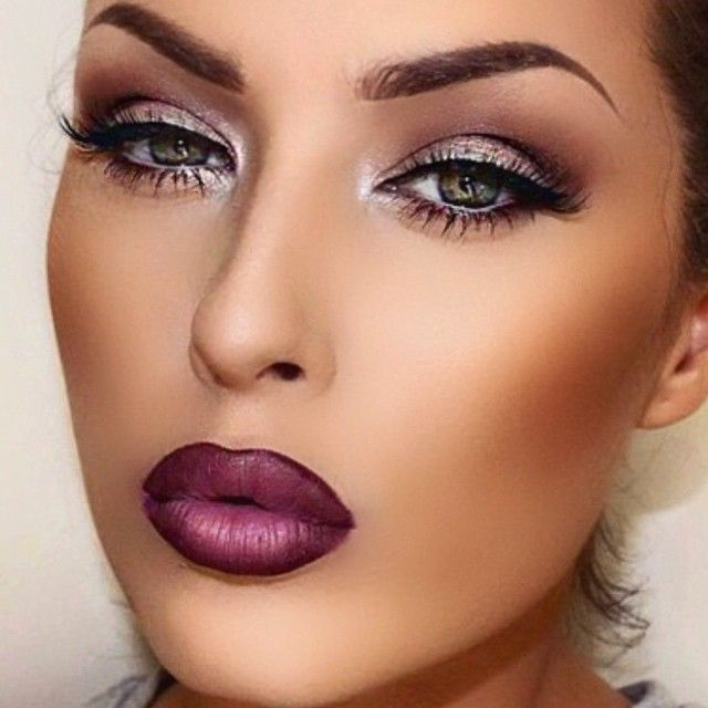 love how the purple eyeshadow brings out the blue in her eyes, and the purple lipliner makes her lips look very full
