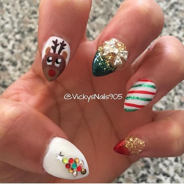 Holiday Christmas nails! Pointy Acrylic nails with Shellac, design and diamonds #nails #vickysnails #nailart #naildesigns #nailswag #cutenails #rednails #sparklynails #christmas #christmasnails #holidaynails #cutenails #naturalnails #reindeernails #Rudolfnails #christmasdesign #xmasnails #holidays #nailsonfleek #shellac #shellacdesign #nailart #frozennails #rednails #greenails #goldnails #sparklynails #sparkleombre #nailselfie #mississauganails #torontonails #bramptonnails #gtanails…