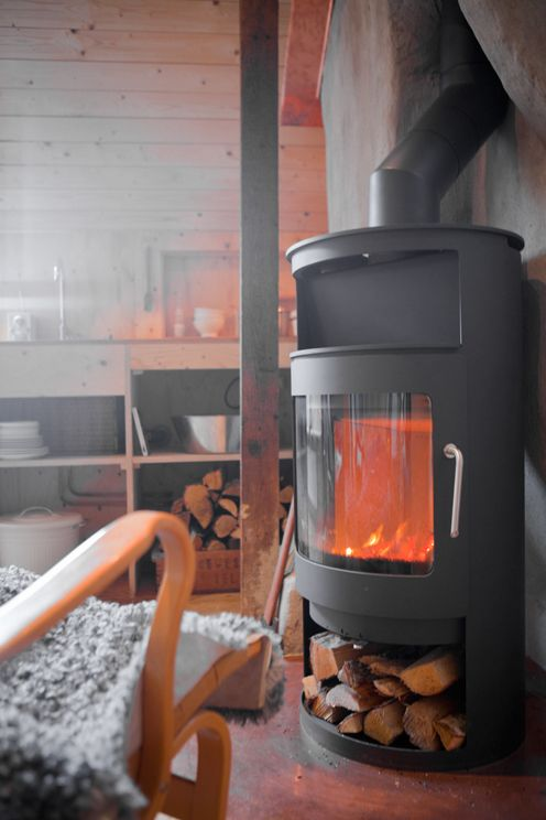 Wood burner and wood panelling.  Anna Backlund via Fine Little Day