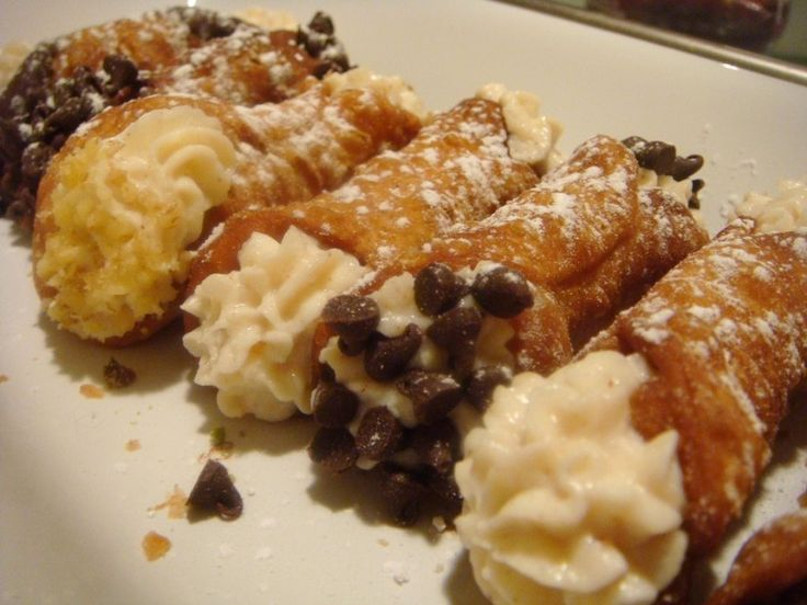 Mini Cannoli Ingredients: 1 Pkg. Shells 16 Oz. Ricotta Cheese 8 Oz. Mascarpone Cheese 1 Tsp. Vanilla 1/2 C. Powdered Sugar 1/3 C. Mini Chocolate Chips 2 Tbsp. Powdered Sugar Directions: Blend Ricotta Mascarpone remove lumps add all ingredients. Cover refrigerator 30 minutes. With piping bag a tip fill shells sprinkle with chips dust with sugar.