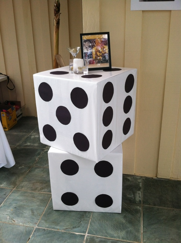 Giant Dice for Casino/Bond party - make with cardboard boxes, white paper, and black construction paper.