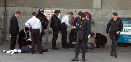 Heavily armed police arrest Keith George Faure, his de facto wife, and a second man, Euangelos Goussis at the Bay City Plaza in Geelong on 19 May 2004. Faure and Goussis were ultimately both convicted of the murders of Lewis Moran on 31 March 2004 and Lewis Caine on 8 May 2004.