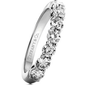 Platinum band with a half circle of round diamonds by Tiffany & Co.