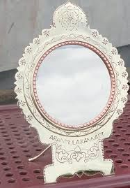 Aranmula Kannadi is a traditional handicraft mirror from a village in Kerala. And it has many myths and stories about this mirror .Shop it online from devotional store. #AranmulaMirror #AranmulaKannadi #Mirror #MetalicMirror #Aranmula #KeralaTraditional #DevotionalStore